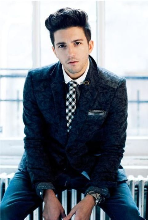 John Magaro giving a pose in on of his photoshoots.