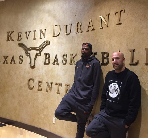 Rich Kleiman poses alongside Kevin Durant in front of Kevin Durant Basketball Center.