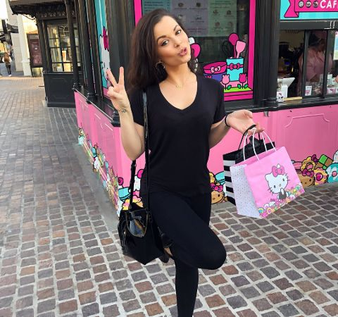 Chelsea Korka in a black outfit shopping.