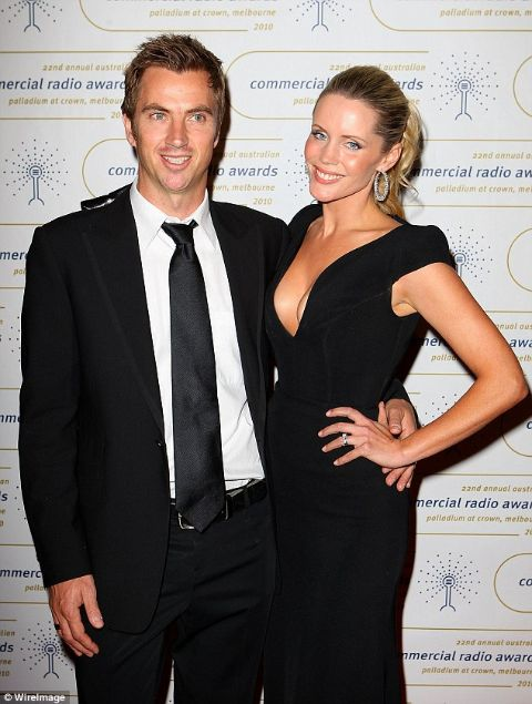Sophie Falkiner giving a pose along with her ex-husband, Tony Thomas in an event.