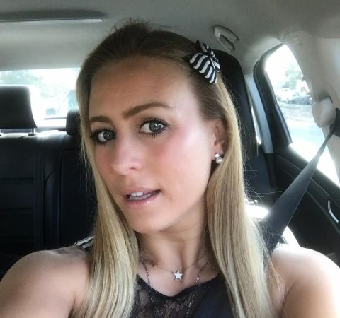 Angelique Kenney in a car poses for a selfie.