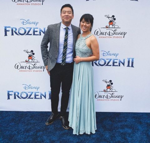 David So in a grey suit with fiance Mariel Song in a light blue dress.