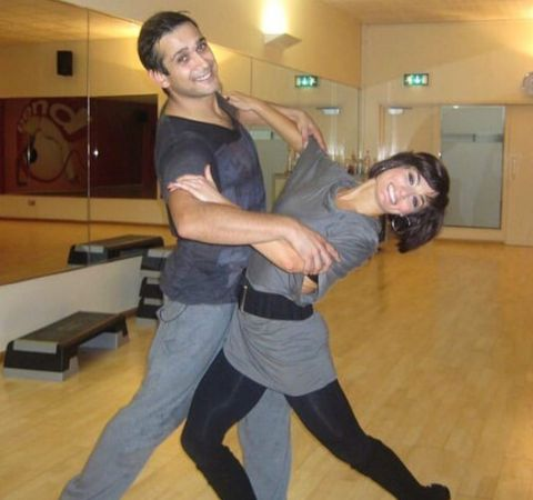 Jimi Mistry in a black t-shirt dancing with wife Flavia Cacace.