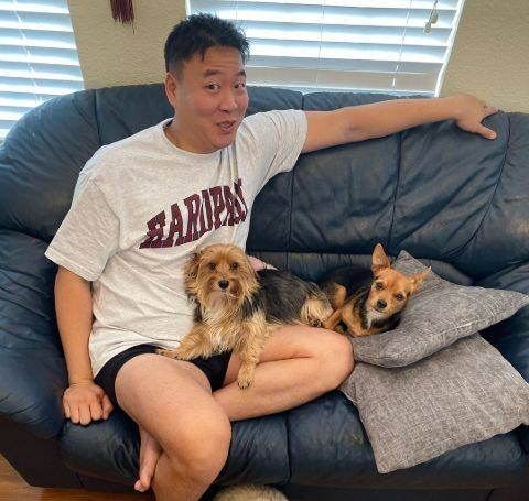 David So, a fond dog lover with two adorable puppies.