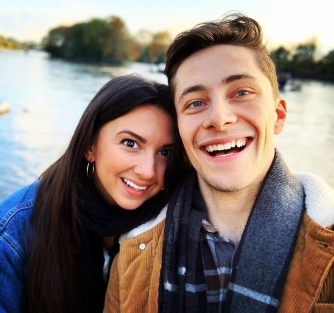 Zizi Strallen in blue poses for a selfie with partner Adam Davidson.
