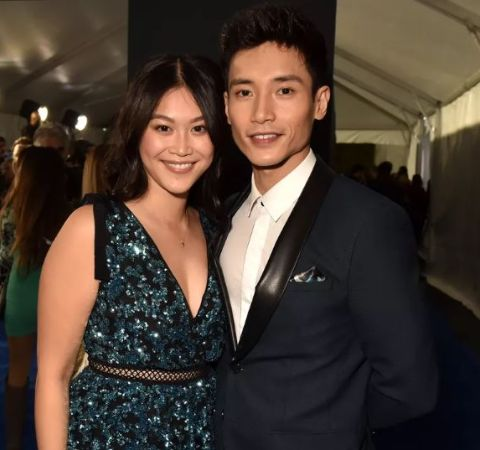 Manny Jacinto in a black suit poses with soon to be bride Dianne Donn.