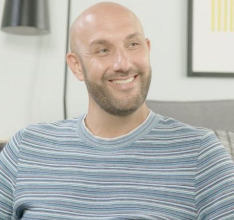 Rich Kleiman in a grey t-shirt caught on camera during an interview.