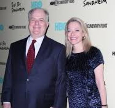 Alex Witchel in black dress poses with her multi-millionaire husband Frank Rich.