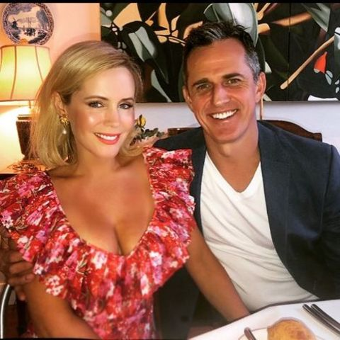 Sophie Falkiner giving a pose along with her partner, Steven Boggiano.