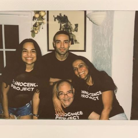 Freddy Miyares giving a pose along with his family.