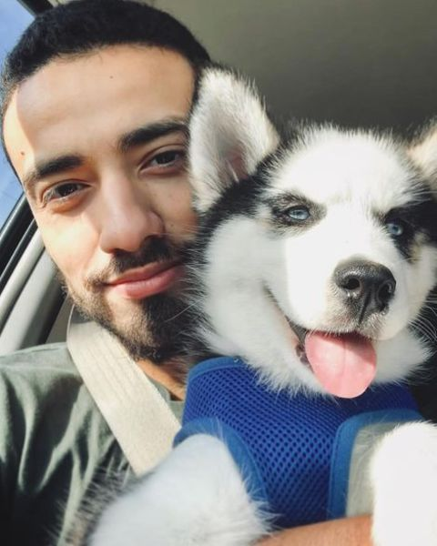 Freddy Miyares taking a selfie with his pet dog, Luna.