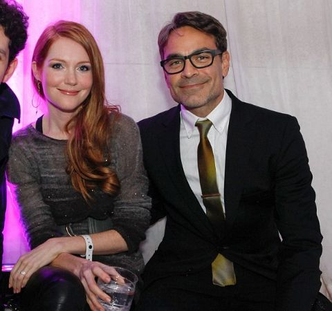 Darby Stanchfield with her husband Paul Stanchfield pose for a picture.