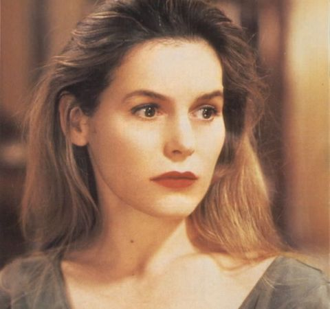 Alice Krige in a brown outfit caught on camera while acting.