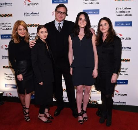 Sherri Kramer's ex-husband poses with their daughters at an event.