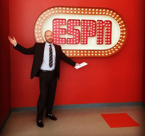 Ryen Russillo in a black suit at the sets of ESPN.