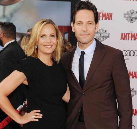 Julie Yaeger in a black dress poses with a actor cum husband Paul Rudd.