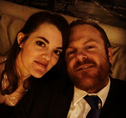 Jeremy Bobb in a suit poses with girlfriend Rachel Whitney,