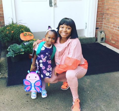 Naturi Naughton in a pink dress poses a picture alongside her daughter.