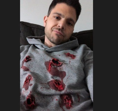 Jerry Ferrara in a grey sweater poses for a selfie.