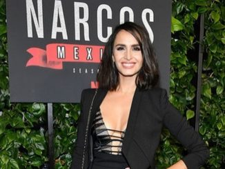 Fernanda Urrejola in a black dress poses at the premiere of Netflix season 2.