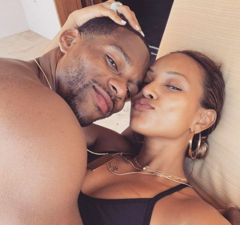 Karrueche Tran  in a black top poses a picture with lover Victor Cruz in bed.