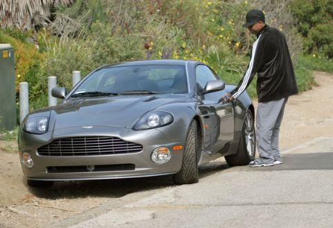 Katia Washington's father Denzel along with his Austin Martin car.
