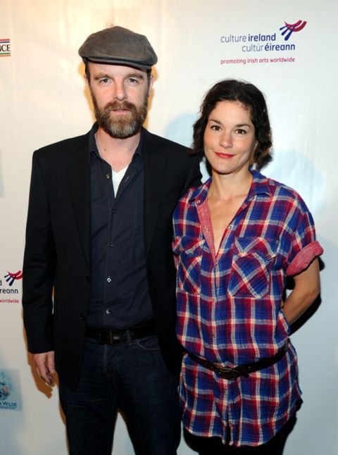 Brian F. O'Byrne giving a pose along with his wife, Heather Goldenhersh.