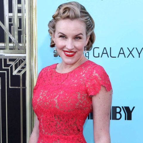 Actress, Kate Mulvany giving a pose in an event.