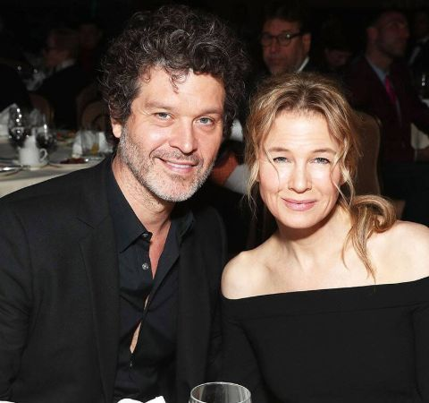 Doyle Bramhall II in a black shirt poses with ex-girlfriend Renee Zellweger.