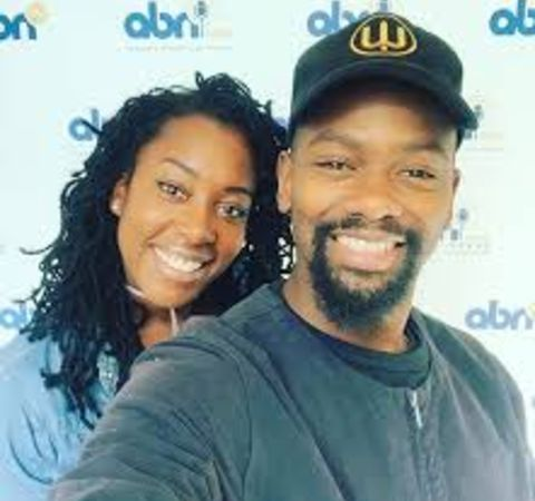 David Ajala in a black t-shirt clicks a selfie with wife Terri Martin.