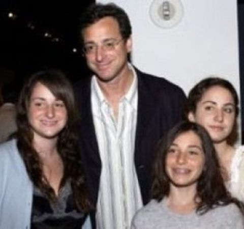 Jennifer Belle Saget poses alongside her dad and sisters.