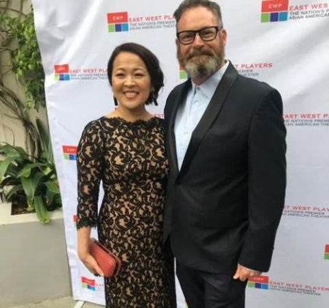 Suzy Nakamura and her husband Harry Hannigan pose for a picture.