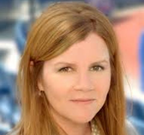 Mare Winningham poses for a picture in a brown hair