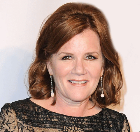 Mare Winningham in a black cloth in  poses for a  picture.