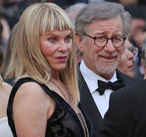Kate Capshaw in a black dress poses with lover Steven Spielberg.