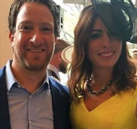 Renee Portnoy in a yellow dress with ex-husband Dave Portnoy.