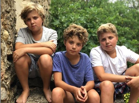 Gilby Griffin Davis giving a pose alongside his brothers.