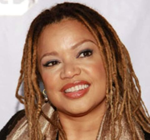 Kasi Lemmons in a black top poses for a picture..
