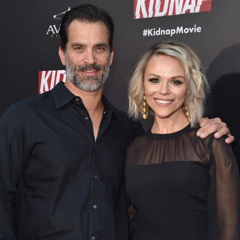 Johnathon Schaech giving a pose along with his wife, Julie Solomon.