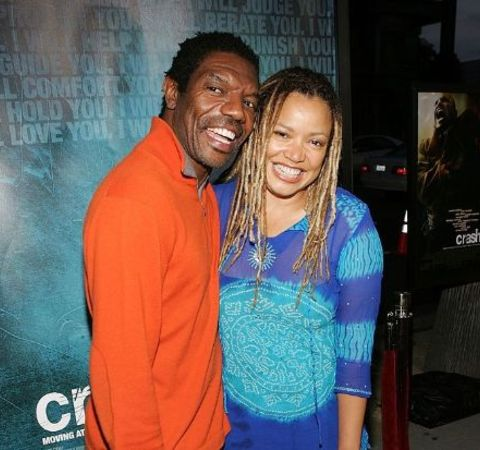 Kasi Lemmons in a blue dress with husband.
