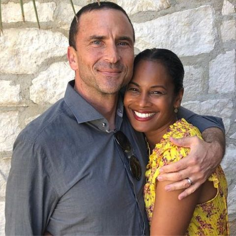 Robinne Lee giving a pose along with her husband, Eric Hayes.