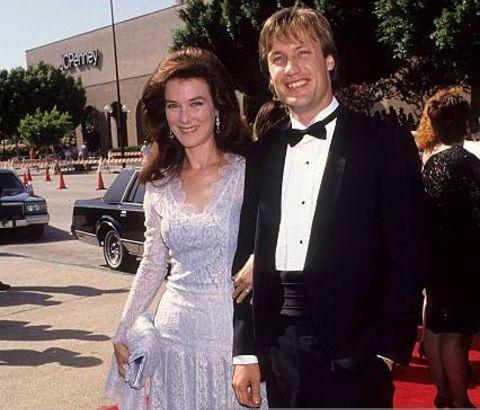 Valerie Mahaffey posing with her husband, Joseph Kell.