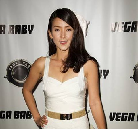 Pamelyn Chee giving a pose in an event.