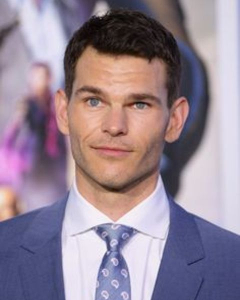 Josh Helman giving a pose in an event.