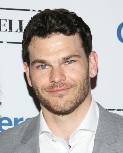 Josh Helman posing in an event.
