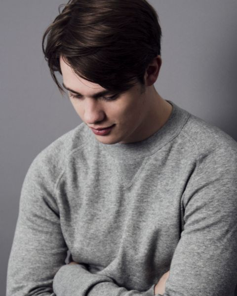 Nicholas Galitzine giving a pose in a photoshoot.