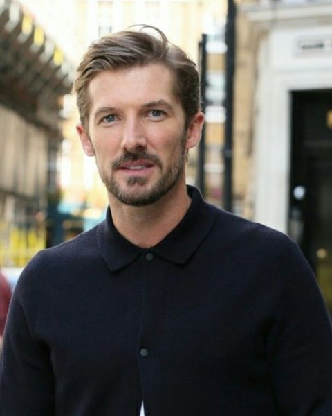 Gwilym Lee giving a pose during a photoshoot.