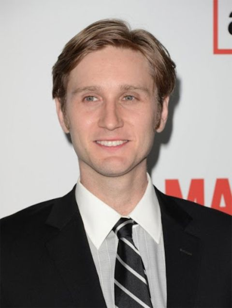 Aaron Staton giving a pose in an event.
