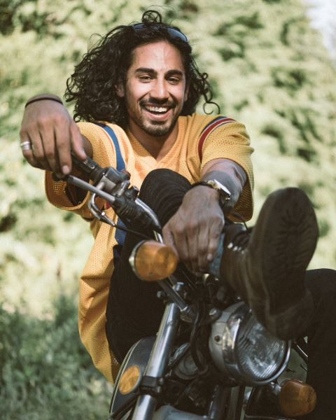 Andres Joseph poses a picture in his bike
