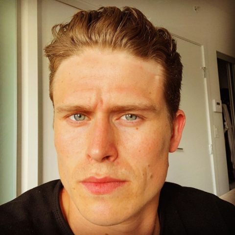 RJ Fetherstonhaugh in a black t-shirt poses for a selfie.